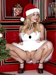 Mia Malkova is posing erotic teenie style on Christmas day